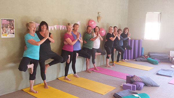 Pink yoga class Randwick, Sydney. smiling senior yoga participants
